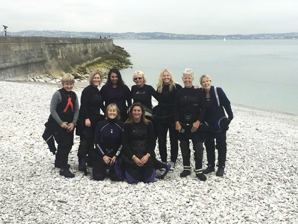 The women of Scuba Blue at Brixham Breakwater Beach