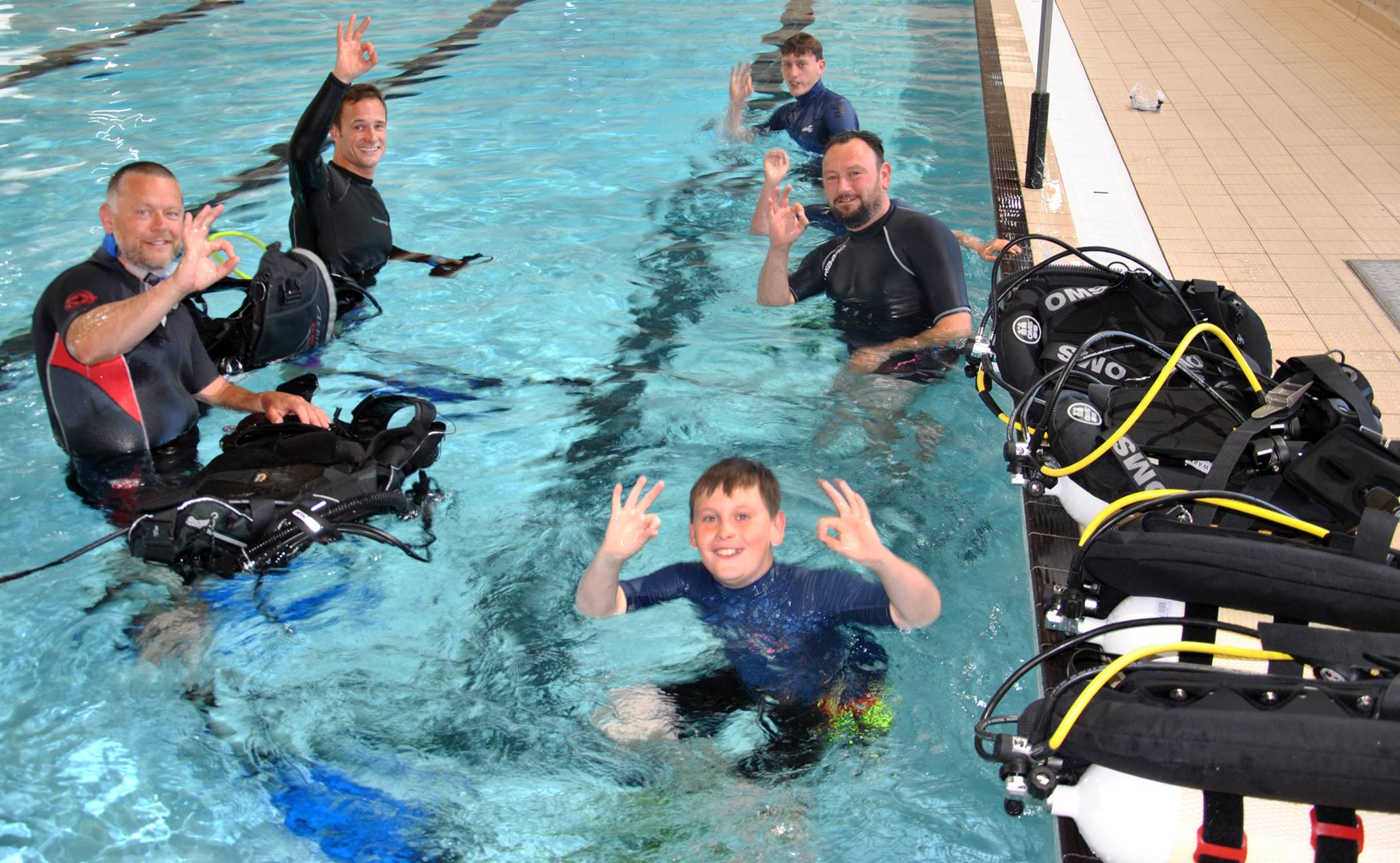 Happy try divers having a scuba experience